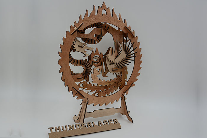 wood Dragon and Phoenix fight laser cutter